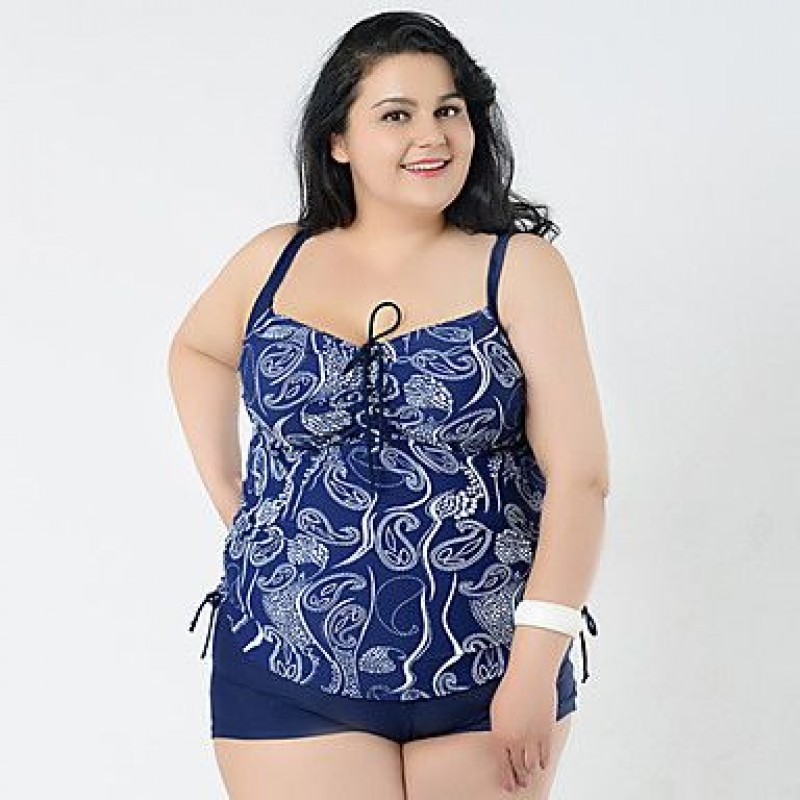 Plus size swimwear at its most magical, the rich colors and micro-cutouts show off just enough while leaving the rest alluringly—and securely, thanks to Elomi's bra-size swimsuit know-how—under wraps. It's clear Elomi swimwear has got this whole goddess thing on lock.